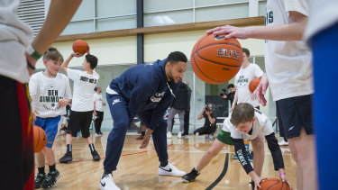 NBA star Ben Simmons with kids at his basketball camp in Donvale.