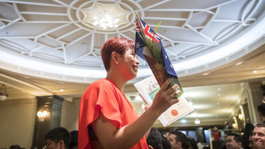 Three hundred new Australians received their citizenship at an Australia Day ceremony at Melbourne Town Hall.
