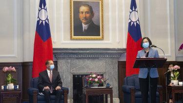 US Health Secretary Alex Azar, left, listens as Taiwan's President Tsai Ing-wen talks on Monday.