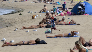 Beachgoers in  St Kilda on Tuesday.