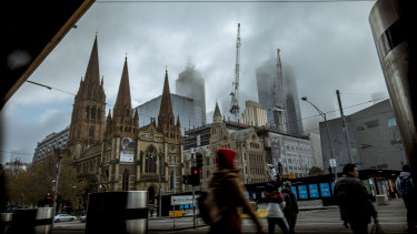 Fog over Melbourne on Sunday - the coldest June day since 1985, with Monday set to be even colder.