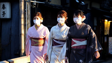 Japanese women wearing face masks in Kyoto.
