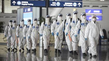 Firefighters prepare to disinfect areas at the Wuhan Tianhe International Airport on April 3.