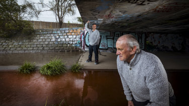Steve Wilson and David Lewis, of the Friends of Stony Creek, were lamenting the condition of the wetland on Monday after it ran blood red.