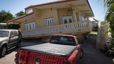A house in Guayanilla, Puerto Rico, is knocked off its foundations by Tuesday's earthquake.