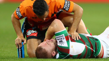 Tom Burgess went down late during South Sydney's 26-18 loss to Melbourne.