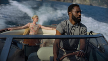Back on the schedule: Elizabeth Debicki and John David Washington in a scene from Christopher Nolan's new sci-fi thriller Tenet.