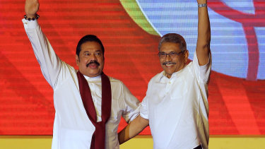Mahinda Rajapaksa, left, and his brother Gotabaya Rajapaksa wave to supporters during a party convention n Colombo last year.