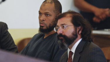 Siraj Ibn Wahhaj, left, sits next to public defense attorney Aleks Kostich at a first appearance in New Mexico state district court in Taos, NM.