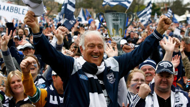Frank Costa celebrates with fans after the Cats' grand final win in 2009.