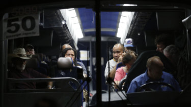 Festival attendees are taken away on a bus following a shooting at the Gilroy Garlic Festival on Sunday.