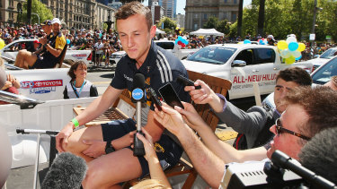 Former Hawk Billy Hartung speaks during the 2015 grand final parade, having been dropped from Hawthorn's team.