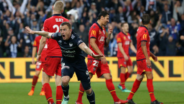 On target: Besart Berisha wheels away in delight after putting Victory 2-1 up against Adelaide in the 89th minute of the A-League elimination final at AAMI Park.