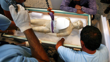 Technicians of Greek Culture Ministry remove the Kritios Boy, a 480 B.C. statue of a youth from the old Acropolis Museum being moved to a new museum.