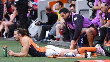 Phil Davis is treated on the sideline.