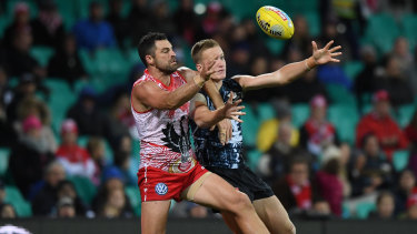 Sydney's Heath Grundy battles with Carlton's Patrick Kerr.