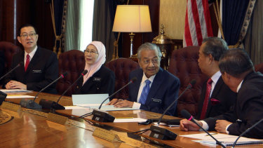 Malaysian Prime Minister Mahathir Mohamad, centre, chairs his first cabinet meeting last week.