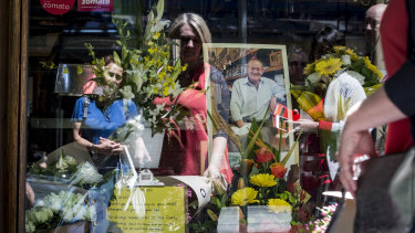 Mourners pay their respects to the co-owner of Pellegrini's Sisto Malaspina after he was stabbed in the Bourke Street incident on Friday.