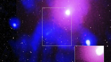 The Ophiuchus galaxy cluster viewed in a composite of X-ray, radio and infrared data. The bottom right image confirmed the record-breaking explosion created a crater so large it could hold 15 Milky Ways.