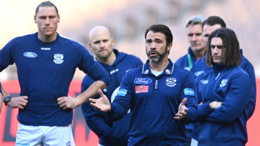 Pep talk: Cats coach Chris Scott speaks to his players during the round 4 clash against the Demons at the MCG.