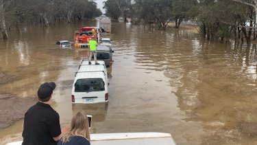 A line of cars in floodwaters on the Hume Freeway near Wangaratta on Thursday.