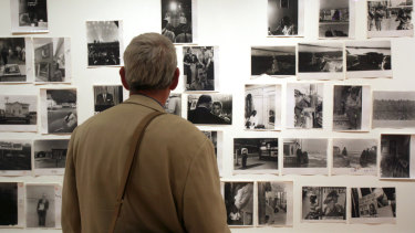 "A man looks at Robert Frank prints at ""The Americans"" exhibit at the Museum of Modern Art in San Francisco in 2009."