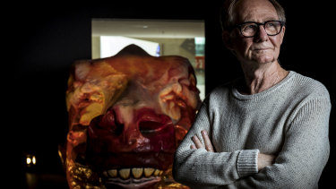 Artist Ivan Durrant with his sculpture of a skinned cow's head at the National Gallery of Victoria Australia.