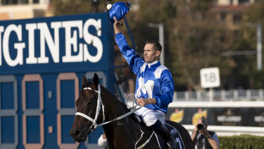 Hugh Bowman salutes the crowd after winning on Winx at Randwick.