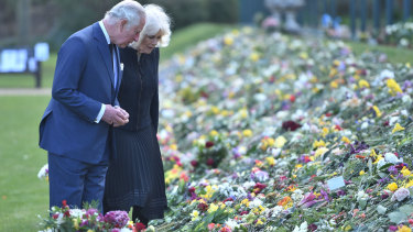 Prince Charles and Camilla, the Duchess of Cornwall, inspect flowers left for Prince Philip.