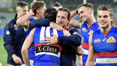 Luke Beveridge will coach the Western Bulldogs for a further three seasons.