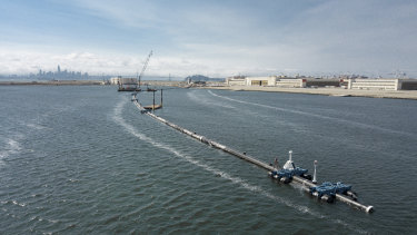 The Ocean Cleanup, a floating boom to corral plastic litter in the Pacific Ocean, is assembled in Alameda, California.