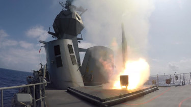HMAS Toowoomba fires a missile during exercises in the Pacific in 2018.