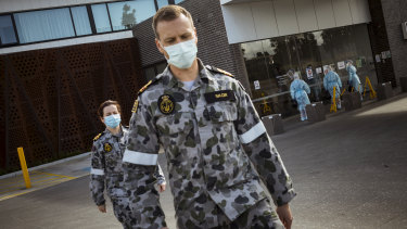 ADF troops help health workers at Epping Gardens Aged Care in Melbourne on Tuesday.