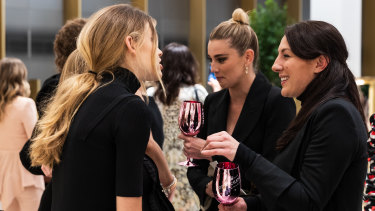 Jasmine Yarbrough, Victoria Lee and a guest mingle at the launch of Level 7.