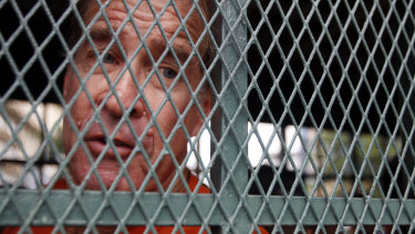 Australian filmmaker James Ricketson on his way to court in Cambodia on Thursday.