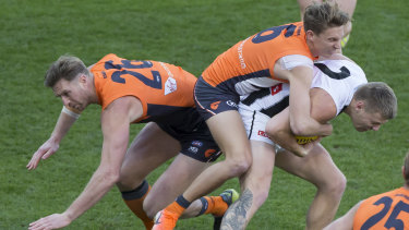 Wrapped up: GWS defender Lachie Whitfield tackles Mapie forward Jordan De Goey.