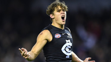 Curnow celebrates a goal in June, 2019, against the Western Bulldogs, just before he was injured.