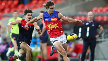 A step ahead: Jarrod Berry sends the ball forward for the Lions.