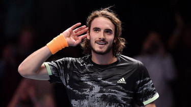 Stefanos Tsitsipas of Greece celebrates defeating Roger Federer at the ATP World Tour Finals in London.