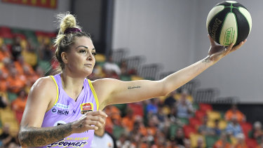 Cayla George of the Boomers takes possession during the round five match against Townsville Fire on Sunday.