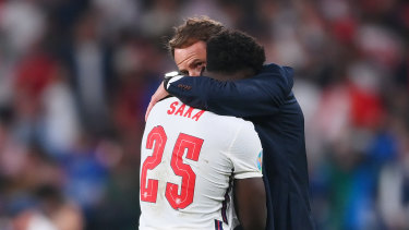 England manager Gareth Southgate consoles Bukayo Saka after the defeat to Italy.