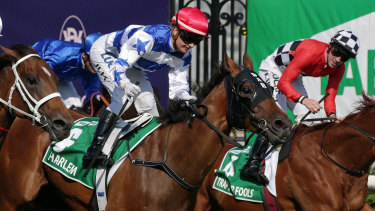 Jamie Kah rides Harlem to victory in race 8 at Flemington on Super Saturday.