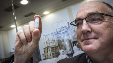 CSL's Chief Scientific Officer Dr Andrew Nash with a replica 1ml vial of the cells that will enter a Biorector to replicate and make 30 million doses of the University of Oxford/AstraZeneca Vaccine candidate.