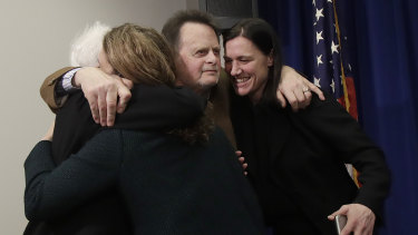Edwin Hardeman, centre, and his wife Mary, left, hug attorneys Jennifer Moore, second from left, and Aimee Wagstaff