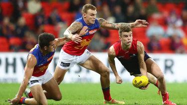 In the Lions' den: Melbourne's Bayley Fritsch handballs under pressure.