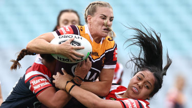 Broncos skipper Ali Brigginshaw charges into the Roosters defence.