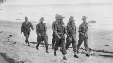 Capt Russell Brereton (centre, light belt) in Labuan, 1945.