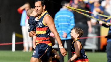 Junior Eds: Crows' milestone man runs on the Adelaide Oval with his children before the match against the Suns.