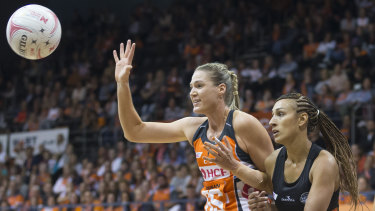 Caitlin Bassett takes the lead over Magpie Geva Mentor in the Giants eight-point Super Netball win on the weekend.