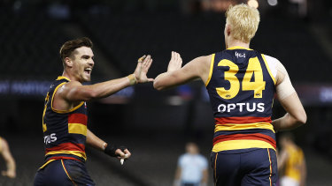 Ben Keays and Elliott Himmelberg celebrate a Crows goal.